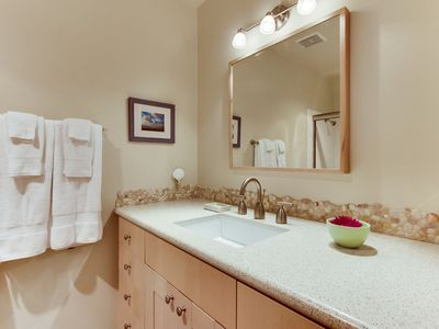 The guest bathroom right across the hall from 2nd bedroom w/shower and bath tub.