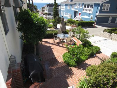 Located on beautiful walk street, BBQ front porch steps from beach & downtown