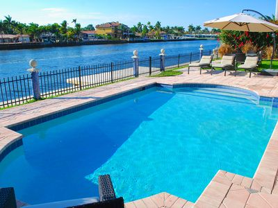 Spacious Rear Yard w/Heated Pool, Lounge Area, Dining & Spectacular Water Views!