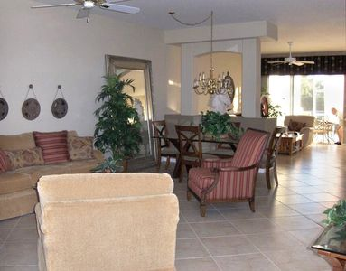 Porcelain tile throughout Living Room leading to Den/Kitchen & Lanai
