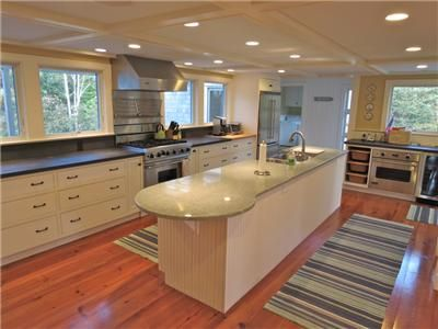 Exquisite spacious chef's kitchen has granite counters and new appliances