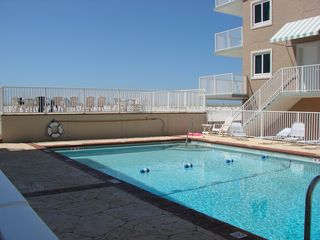 Pensacola Beach condo photo - Swimming pool and upper tanning deck overlooking the ocean.