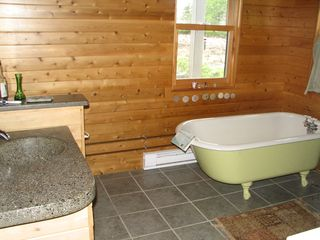 Beals - Great Wass Island cabin photo - Bath. Includes Clawfoot tub, cedar shower (not shown), concrete countertops.