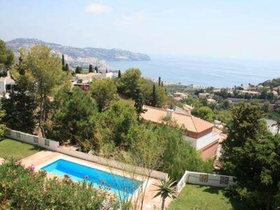 Luxury private villa with large swimming pool and gardens