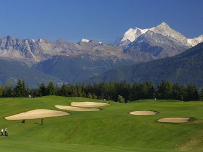 Tee off onto the mountains from the world famous 18-hole golf course of Crans!