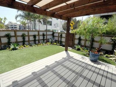Shaded patio/lounge area with barbeque