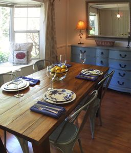 Dining area with farm table and cafe chairs