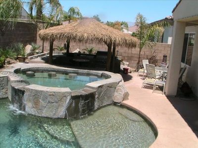 Swim up Bar in Extra Large Spa with Complete Outdoor Kitchen Under a Huge Palapa