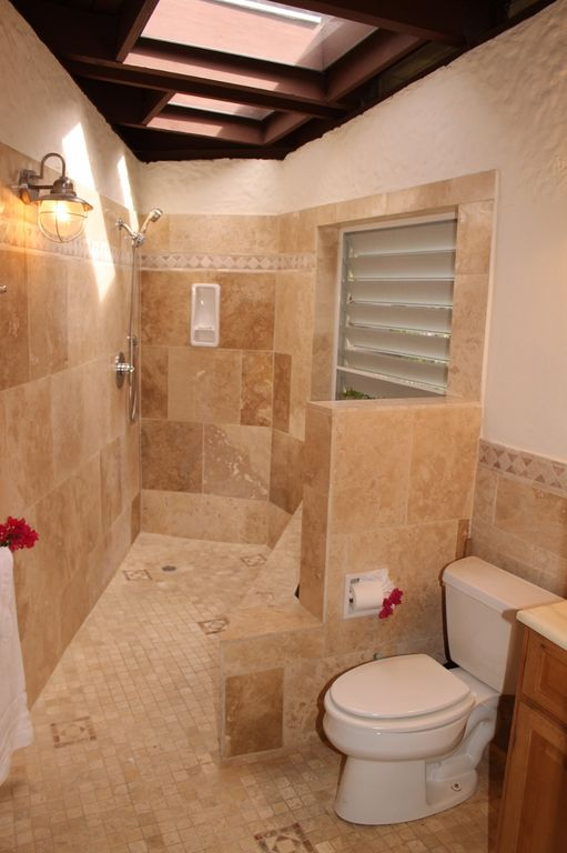 Master bedroom en suite bathroom - elegantly tiled with garden walk-in shower.
