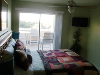 Cape Canaveral condo photo - Downstaris bedroom and balcony