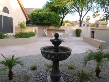 Large Private Yard with a water feature.