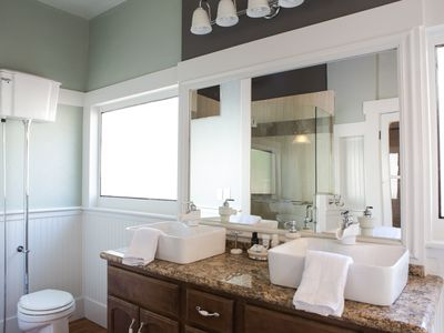 Enjoy the double vanity sink and pull chain toilet in the master bathroom!