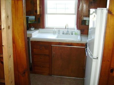 Galley kitchen with stove, oven, dishwasher, microwave, and refrigerator/freezer