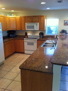 Large gourmet kitchen. Pantry located behind kitchen with washer & dryer.