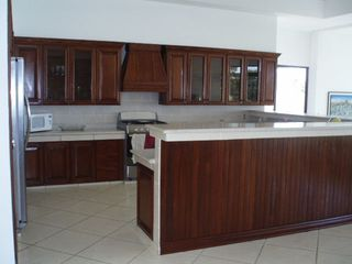 Pochomil estate photo - Kitchen showing breakfast bar and custom hand built artisan cabinetry