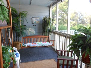 Screened in porch - perfect for mingling after a day at the beach.