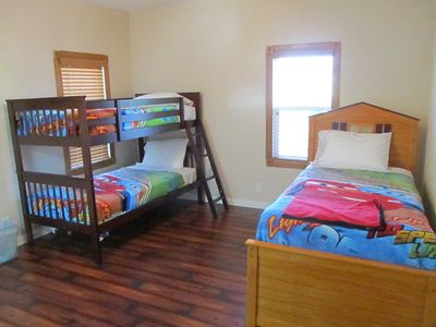 Third bedroom has four twin size beds including bunk bed and trundle bed
