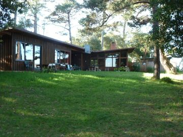 Inverness house rental - The house and meadow perched on the edge of Tomales Bay www.TheWhitneyHouse.com