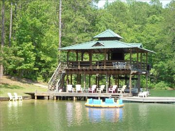 Lake Martin cabin rental - Incredible dock with Upper Deck seating, Bar and 50' TV, steps into water