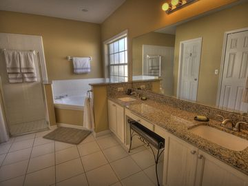 Master bathroom is fully appointed with granite counters, Large walk in closet