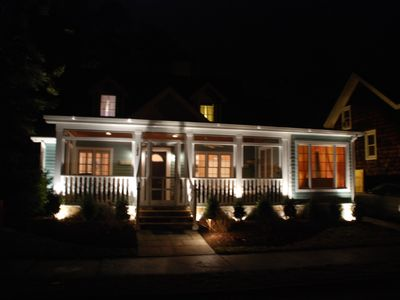 Custom landscape lighting accents the starry skies
