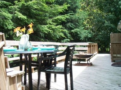 Enjoy a meal and an evening fire on the deck with ample seating