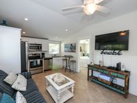 **COCONUT COTTAGE UNIT 1**4-PLEX 3 BEDS 2 BATHS HAS ITS OWN PRIVATE HEATED POOL