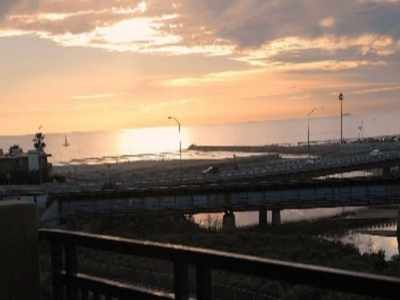 Oceanside condo rental - Beautiful view of the sunset!