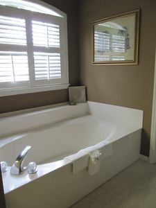 Master bathroom on 2nd floor (tub and shower plus double sinks)