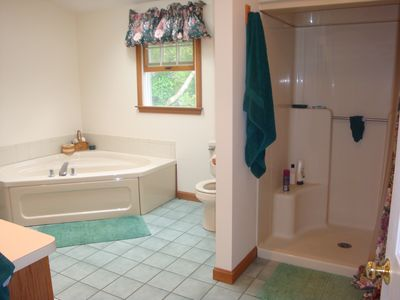 Master bath with shared access to upstairs hallway