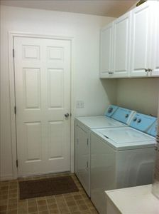 Convenient Indoor Laundry, Garage Access and Laundry Tub