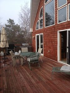 Large front deck for lounging and grilling on weber grill. On main floor area