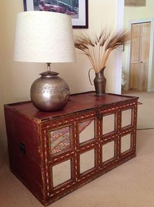 Antique mirrored chest in master bedroom
