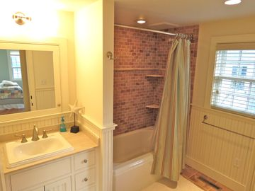 ...has a full bath across hall with a tub/shower combination
