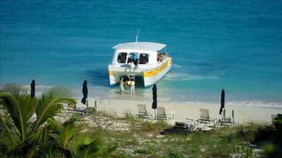 Book a day trip ....most operators offer beach pick up