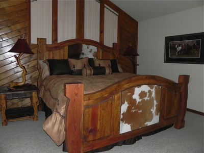 The Master Bedroom with a king bed and pillow top mattress.
