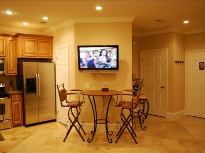 "Travertine, stainless, crown and 42"" LED HDTV"