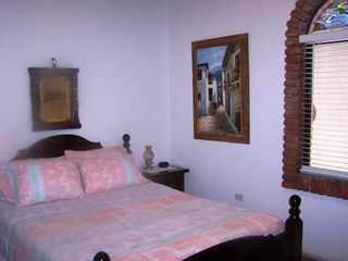Las Gaviotas house photo - The guest bedroom with a queen size bed.