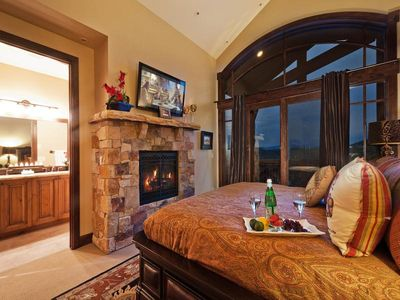 Master king suite with gas fireplace, flatscreen TV, and balcony