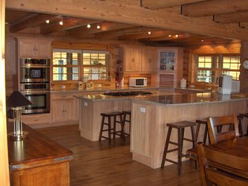 Gourmet kitchen with Canadian maple cabinets and silver/shiraz splashed granite