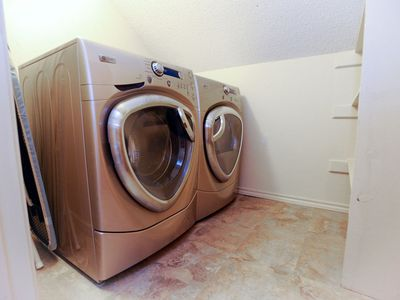 Full size GE profile front-load high efficiency washer/dryer, iron and board