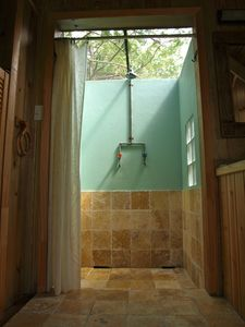 shower in bedroom open to the sky (screened)
