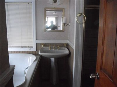En suite master bathroom with large tub and separate shower (Bath 2 of 3)