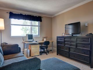 "Victoria townhome photo - Media room/bedroom. Your choice, there is a queen sofa bed, 37"" TV and computer"
