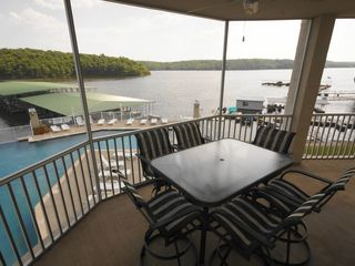 Osage Beach condo photo - Expansive Screened-In Deck Overlooks the Pool, Lake, & Park w/ seating for 1