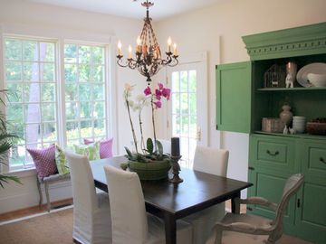 Bright and airy dining room, that is adjacent to the gourmet kitchen.