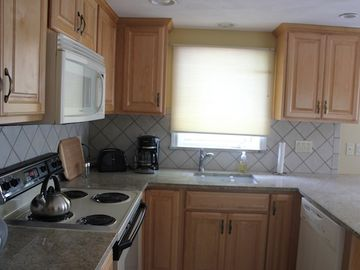 Cooking area with dishwasher and microwave oven