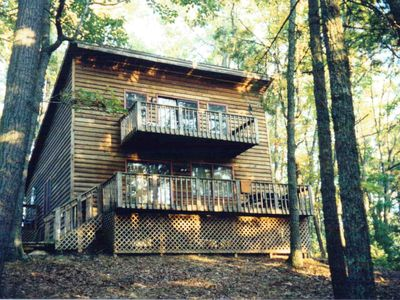cabin from the back side. upstairs balcony off bedroom and down stairs deck.