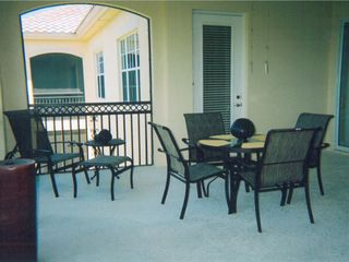 Naples townhome photo - L-shaped Lanai for outdoor dining and relaxation