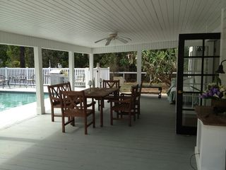 Naples house photo - patio showing barbecue outdoor table and 30 x 15 solar heated swimming pool
